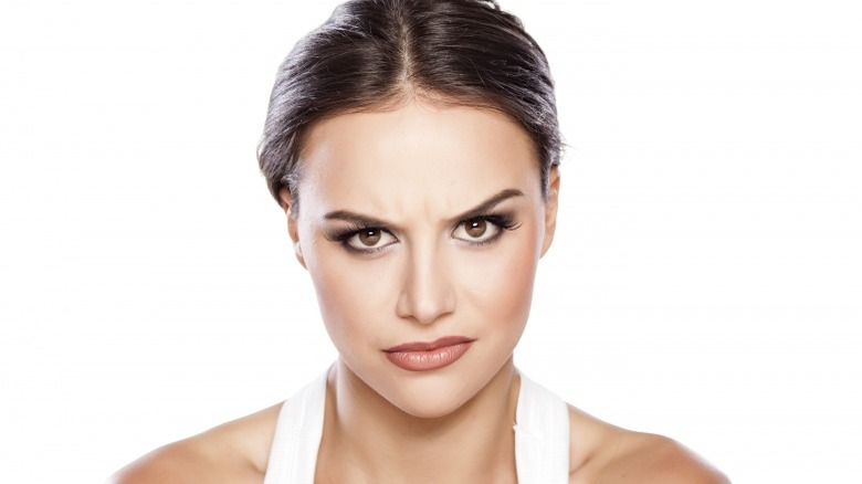 woman not smiling angry