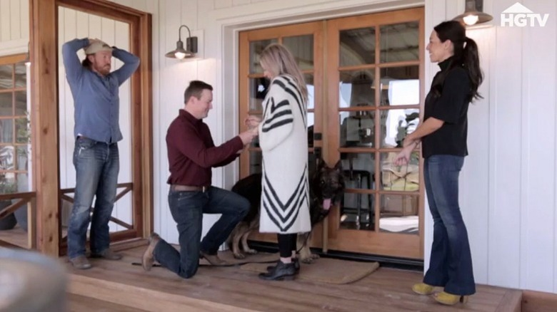Chip and Joanna Gaines with homebuyer proposing