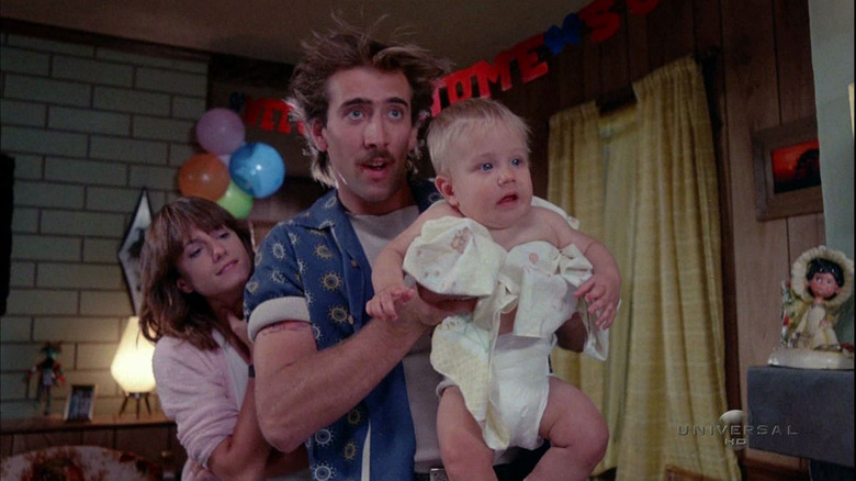 Nicolas Cage holding a baby in Raising Arizona