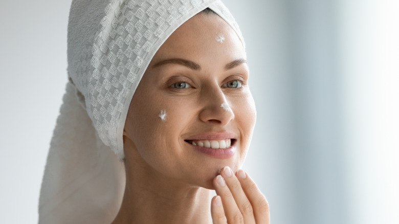 a woman applying a cream, a beauty tip when you're stuck at home