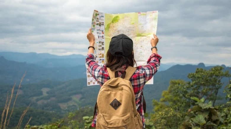 woman traveling looking at map