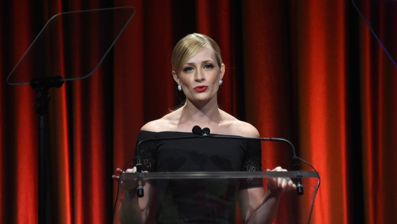 Beth Behrs speaking at a podium