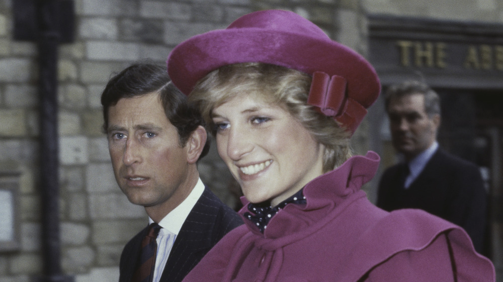 Princess Diana in magenta with Prince Charles