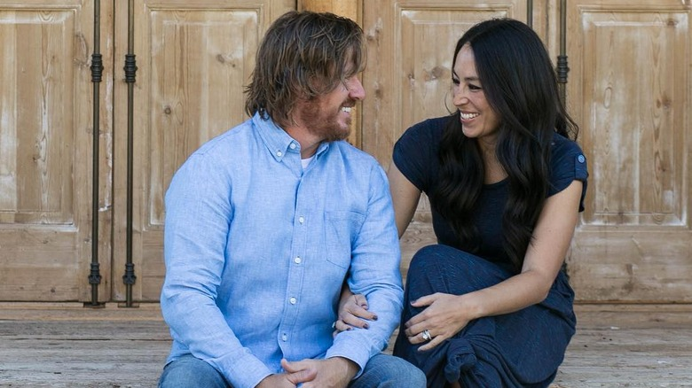 Chip and Joanna Gaines with homebuyer