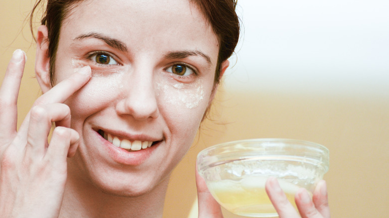 woman applying egg whites to face