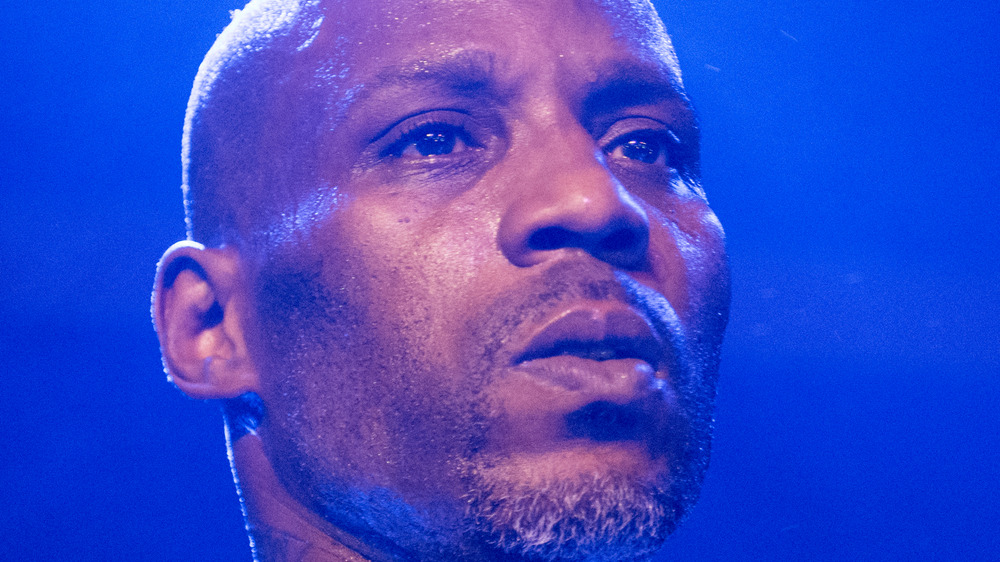 DMX performing on stage with facial hair