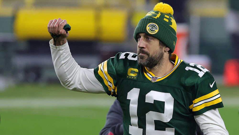 Aaron Rodgers playing football