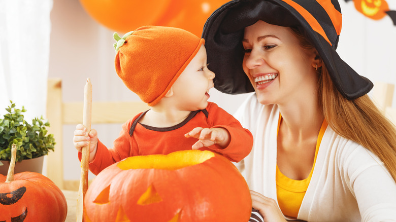 Happy baby in pumpkin Halloween costume