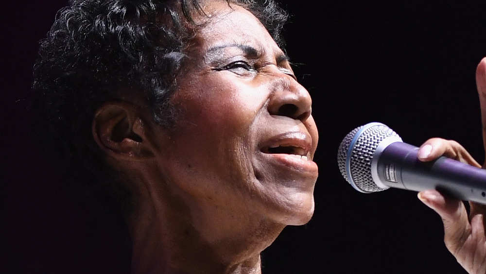 Aretha Franklin singing at an event