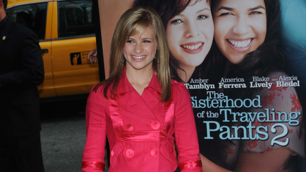 Jenna Boyd smiling at the Sisterhood of the Traveling Pants 2 premiere.