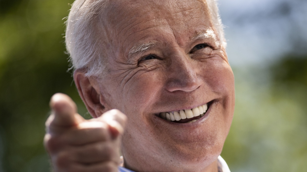 President Joe Biden looks elated onstage