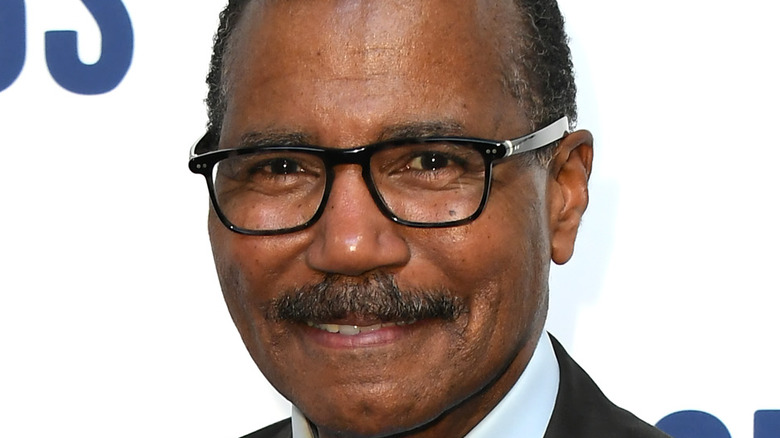 Bill Whitaker smiling in glasses and moustache