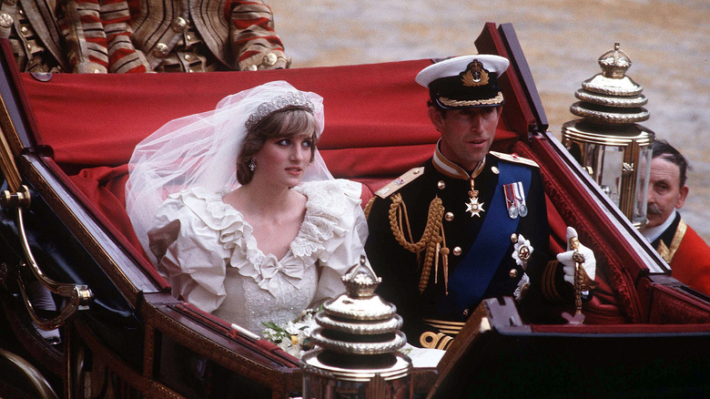 Princess Diana and Prince Charles riding in a carriage on their wedding day