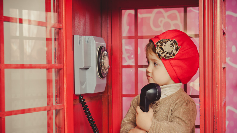 Child in London phone booth