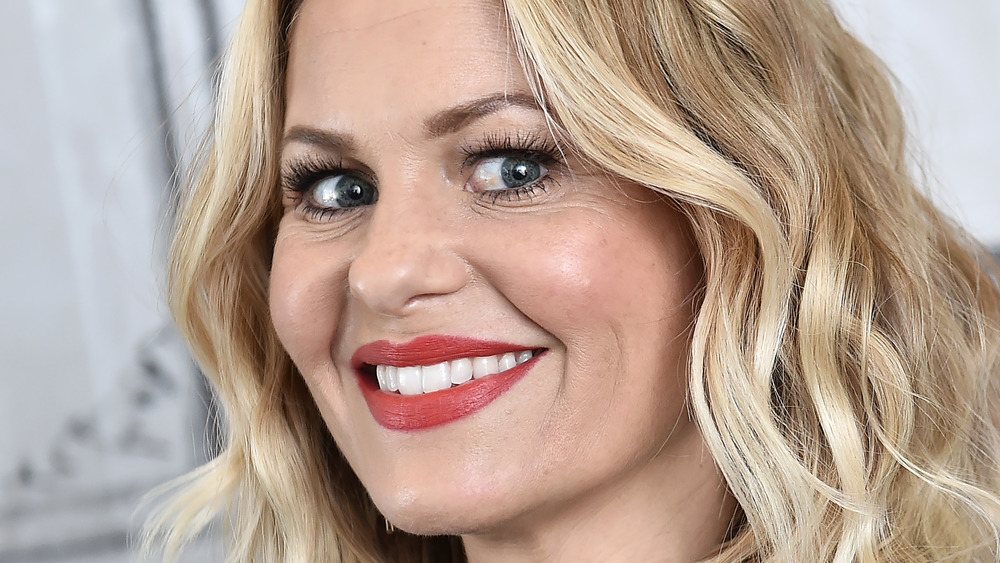 Candace Cameron Bure smiles in black