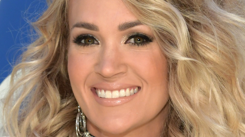 Carrie Underwood smiles with curly hair