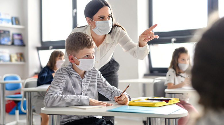 teacher and students wearing face masks in class