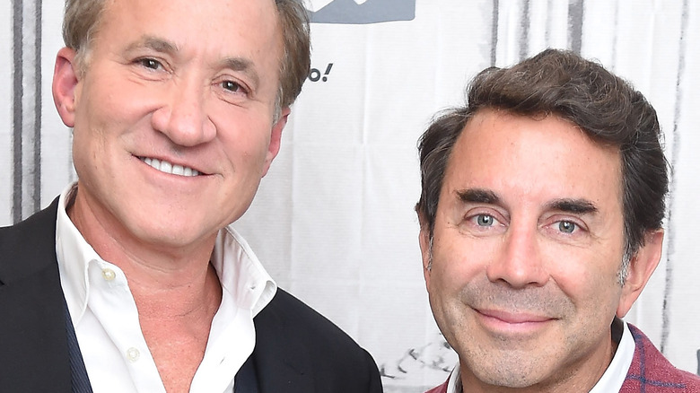 Dr. Terry Dubrow and Dr. Paul Nassif smiling