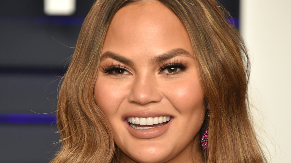 Chrissy Teigen laughs
