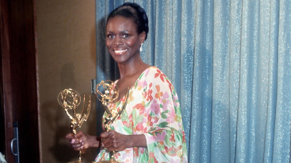 Cicely Tyson poses with her awards