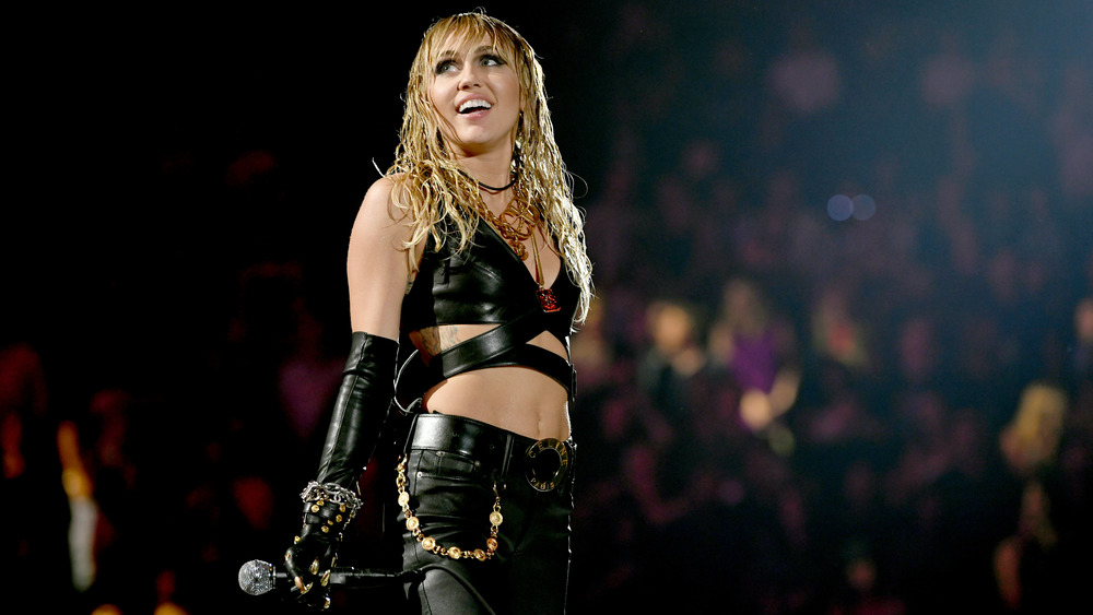 Miley Cyrus smiling on stage