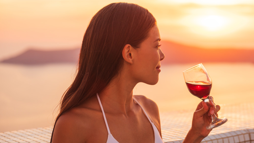A glass of red wine at the beach