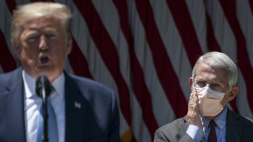 Dr. Fauci looks on as Donald Trump gives an impassioned speech