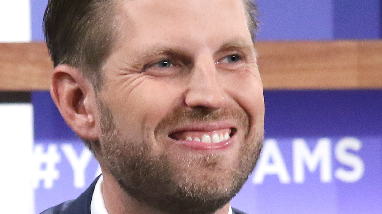 Eric Trump smiling during appearance
