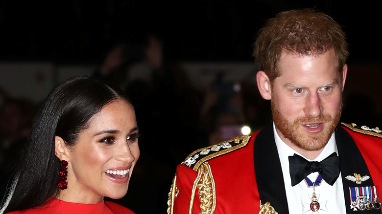 Prince Harry and Meghan Markle wear red
