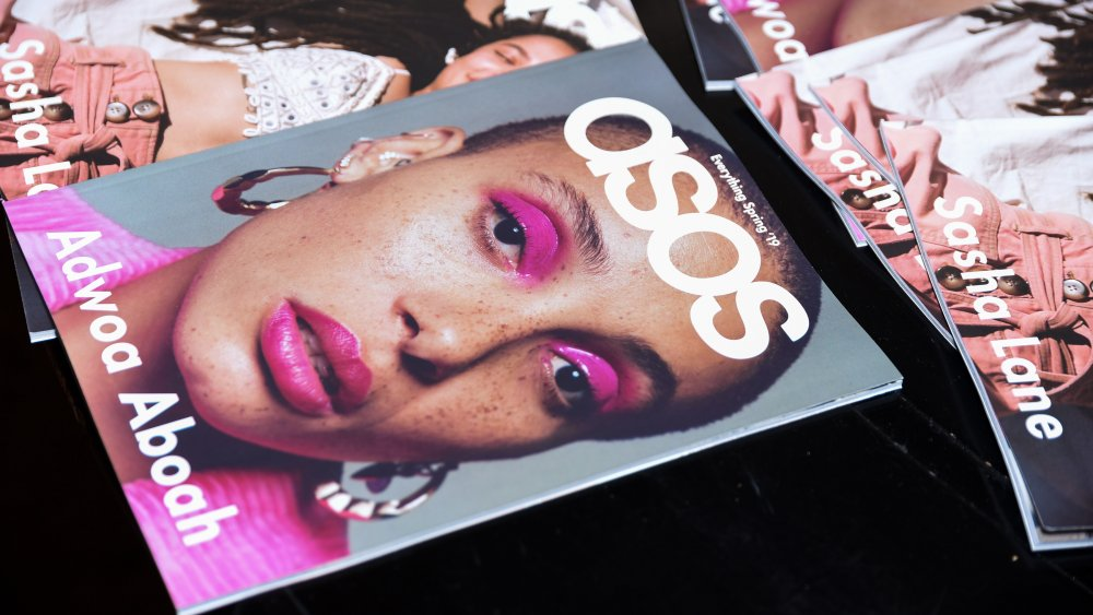 ASOS catalogs on a surface