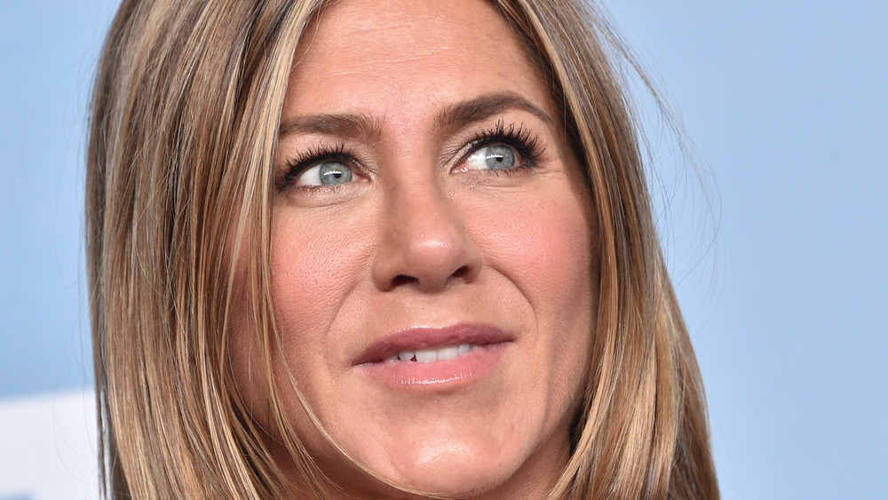 Jennifer Aniston with small smile looking to the side
