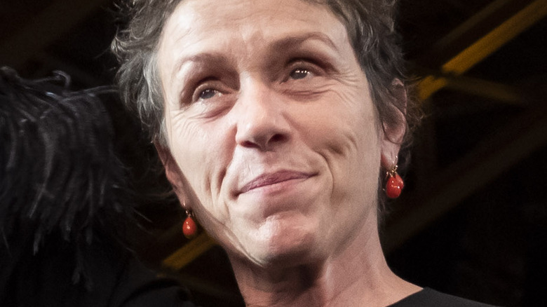 Frances McDormand raising hand