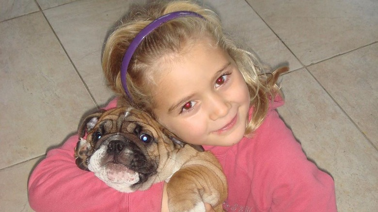Gordon Ramsay's daughter Tilly Ramsay as a child with the family dog