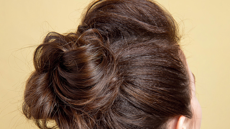 Messy bun with brown hair