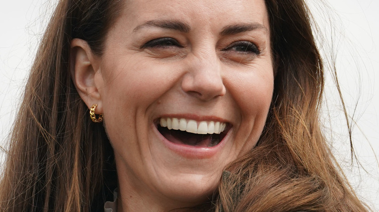 Kate Middleton laughing, cloudy day