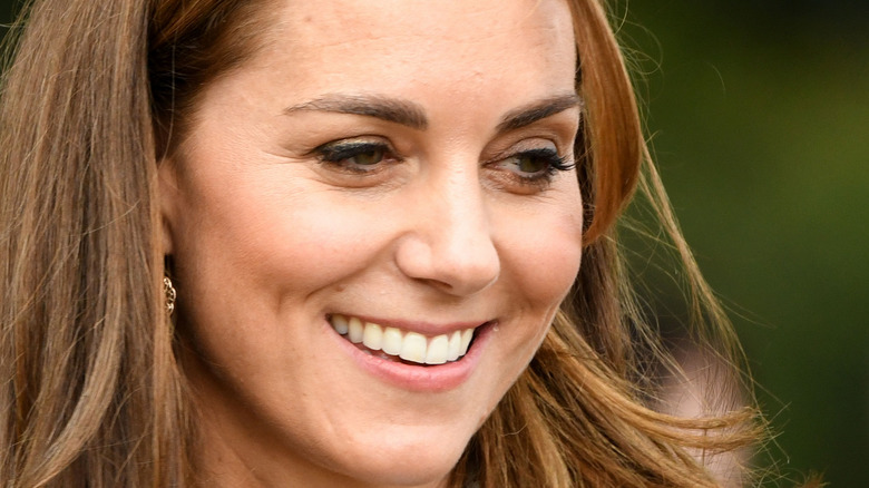 Kate Middleton smiling looking away from camera