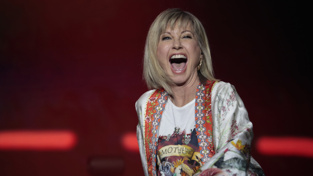 Olivia Newton-John looks super happy