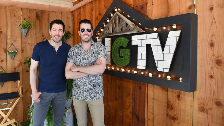 Property Brothers with HGTV sign