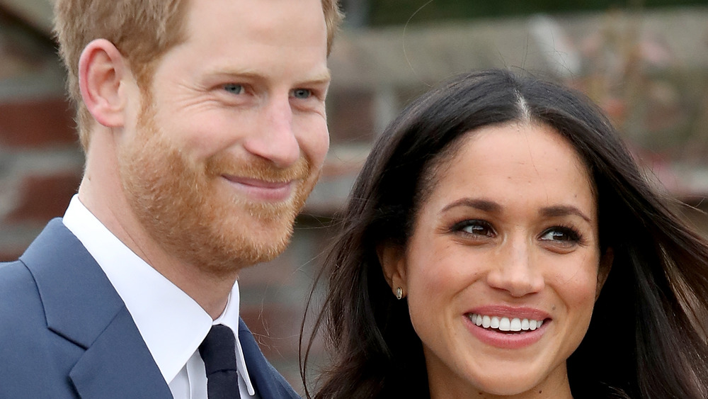 Prince Harry and Meghan Markle smiling together