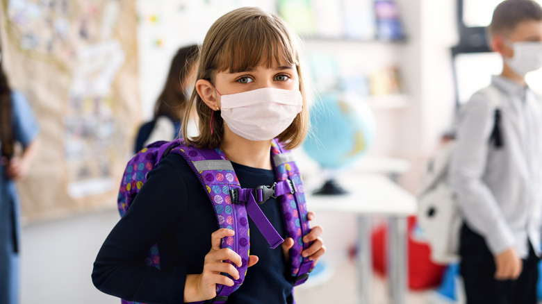 Girl at school wearing face mask