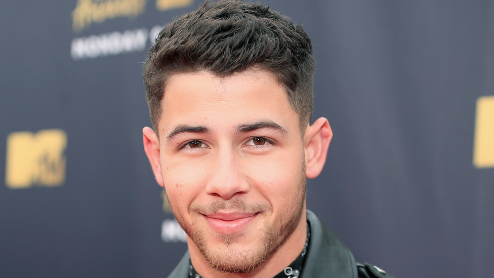 Nick Jonas poses on the red carpet