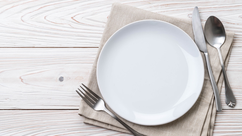 A table setting with a white dish