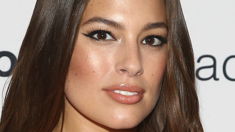 Ashley Graham poses with a small smile.