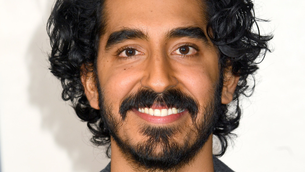Dev Patel smiling