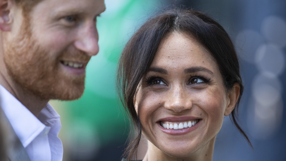 Meghan Markle smiling at Prince Harry
