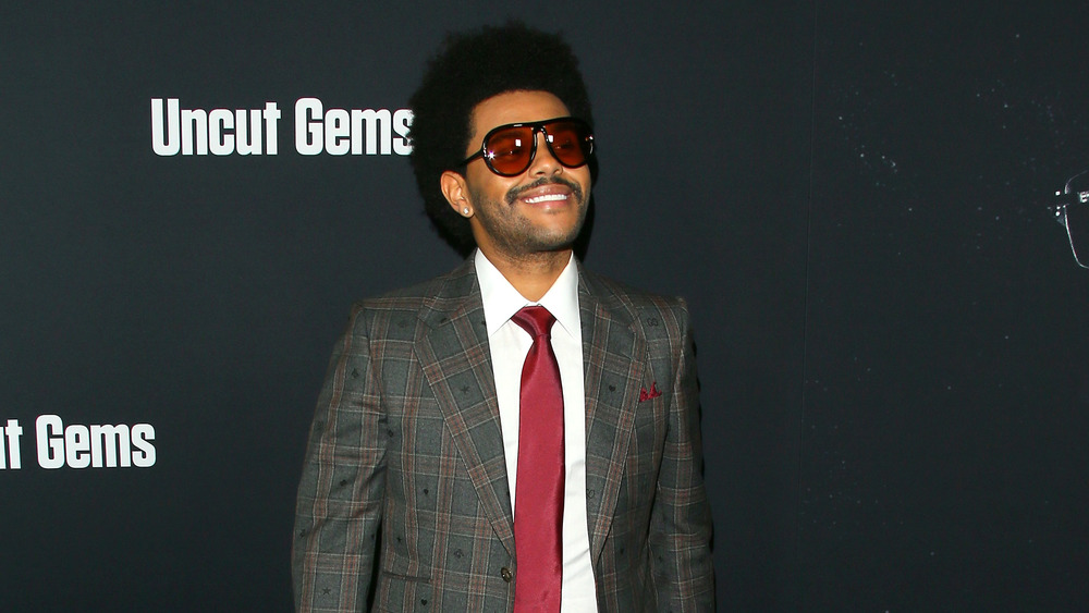 The Weeknd in plaid suit