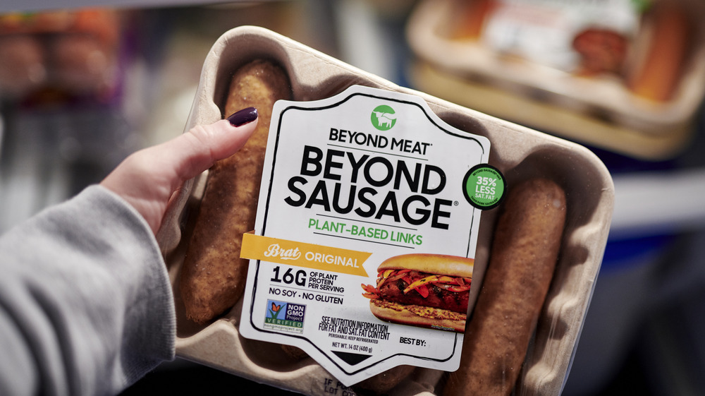 Woman holding Beyond Meat sausages