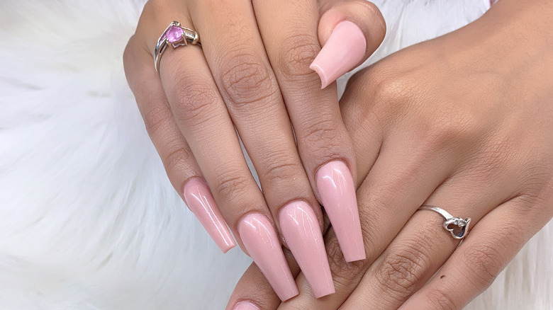 Woman with pink coffin nails