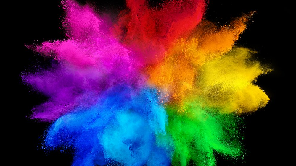 Rainbow of color in front of black background