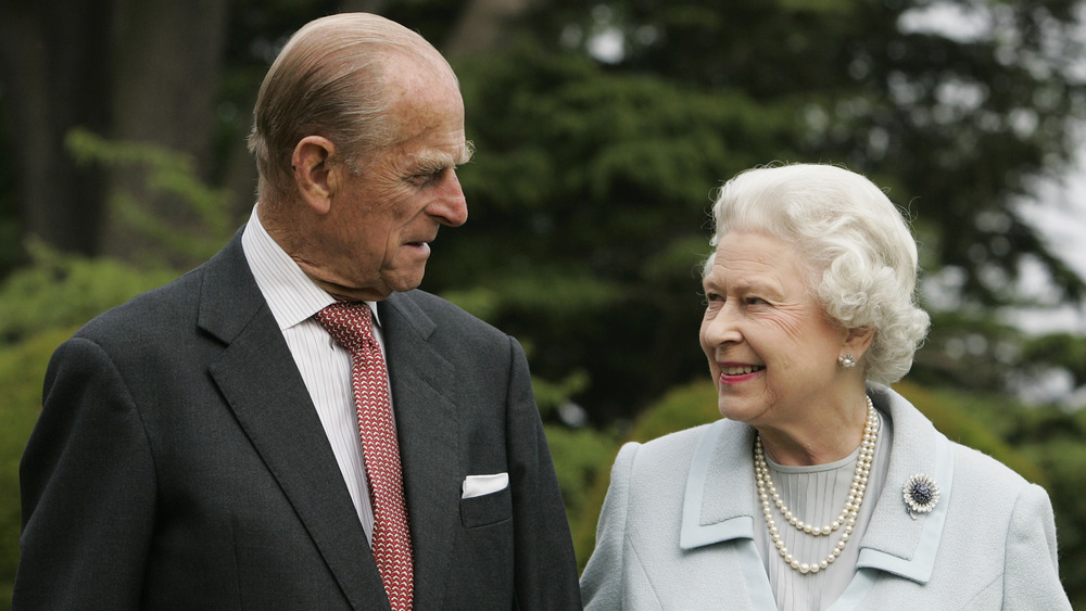 Prince Philip and Queen Elizabeth looking at each other